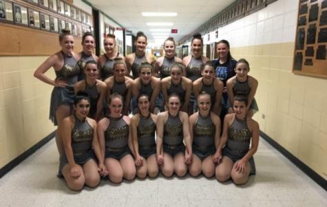 Cheerleading, varsity dance teams take first