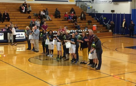 Senior basketball players celebrate final home game with victory