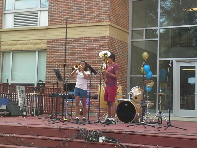 Seniors Isabelle and Nathaniel Blanco perform onstage early in the evening at the Courtyard Concert Sep. 26.