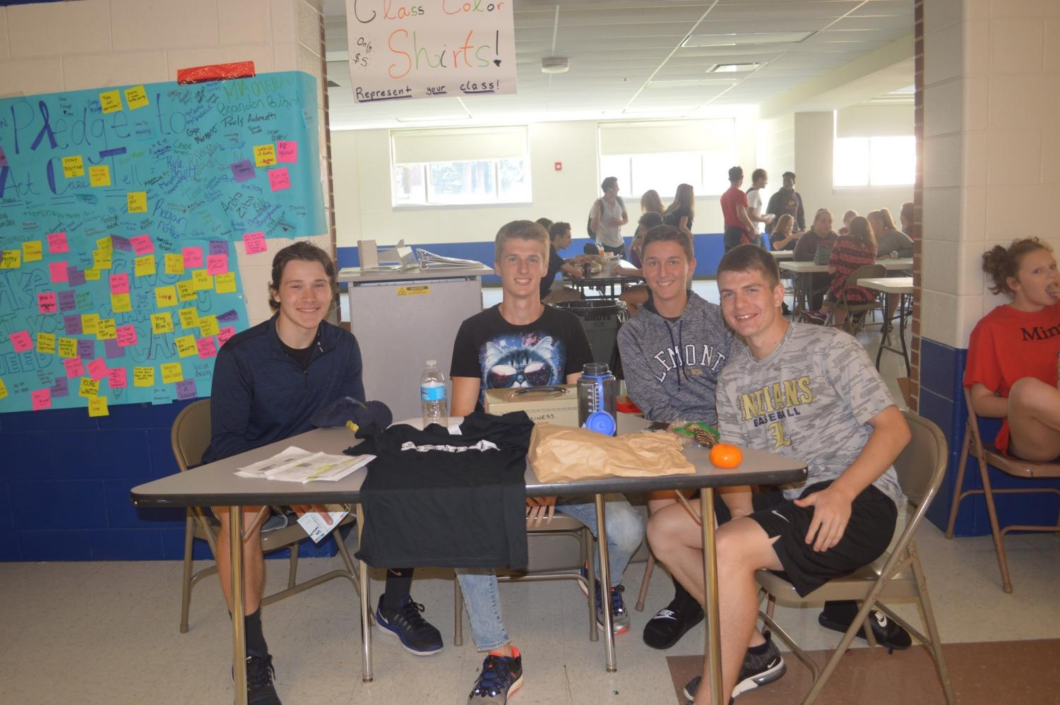 Students sell class color day t-shirts during lunch in the Commons. (left to right; Jacob Koneiczka, Andrew Deuschle,  Logan Kearns, Gavin Pawell)