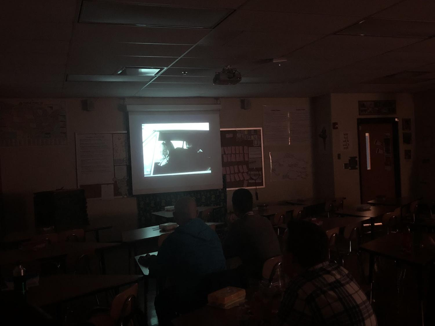 The Film Club meets in their personal theater in room 115, watching Night of the Living Dead.