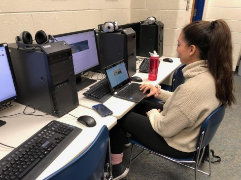 Journalism student Gloria Vargas finishes up an article on her school-issued Chromebook. Personal devices like these are changing the way students interact with technology and learning.