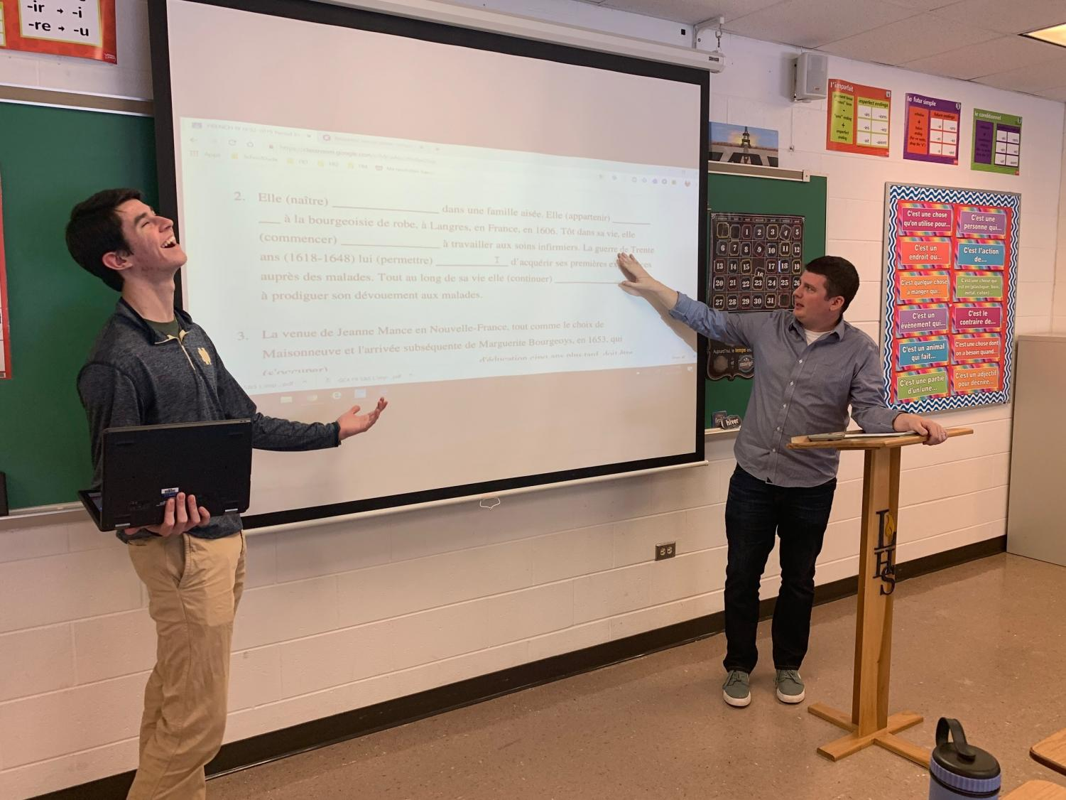 Wojnar teaches senior John Arundel complex grammar skills in preparation for their upcoming quiz. When not learning grammar, Wojnar can usually be found teaching vocabulary units like Religions, Art, or Government.