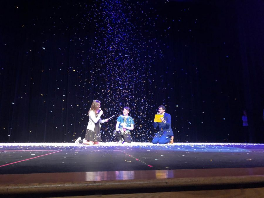 """After being named Mr. LHS, senior Ricky Moravecek was showered by confetti as co-hosts Grace Horky and Kyle Devitt sang an original Mr. LHS-themed song to share in his victory. """"By the end of the night, us guys were having so much fun it didn't even feel like a competition,"""" said Moravecek. Photo by Natalie Palarz"""
