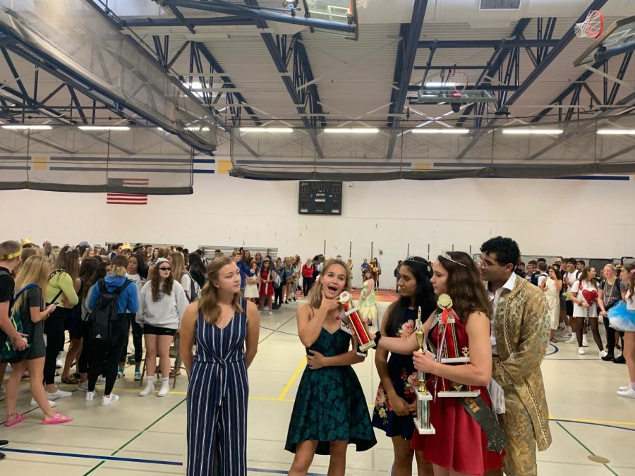Seniors Kyle Devitt, Brie Salomon, Reema Dhawan, Katie Jabaay, and Caroline Bukowski squeezing in a last-minute Miss Universe interview skit, as the judges contemplate how to rank the skits.