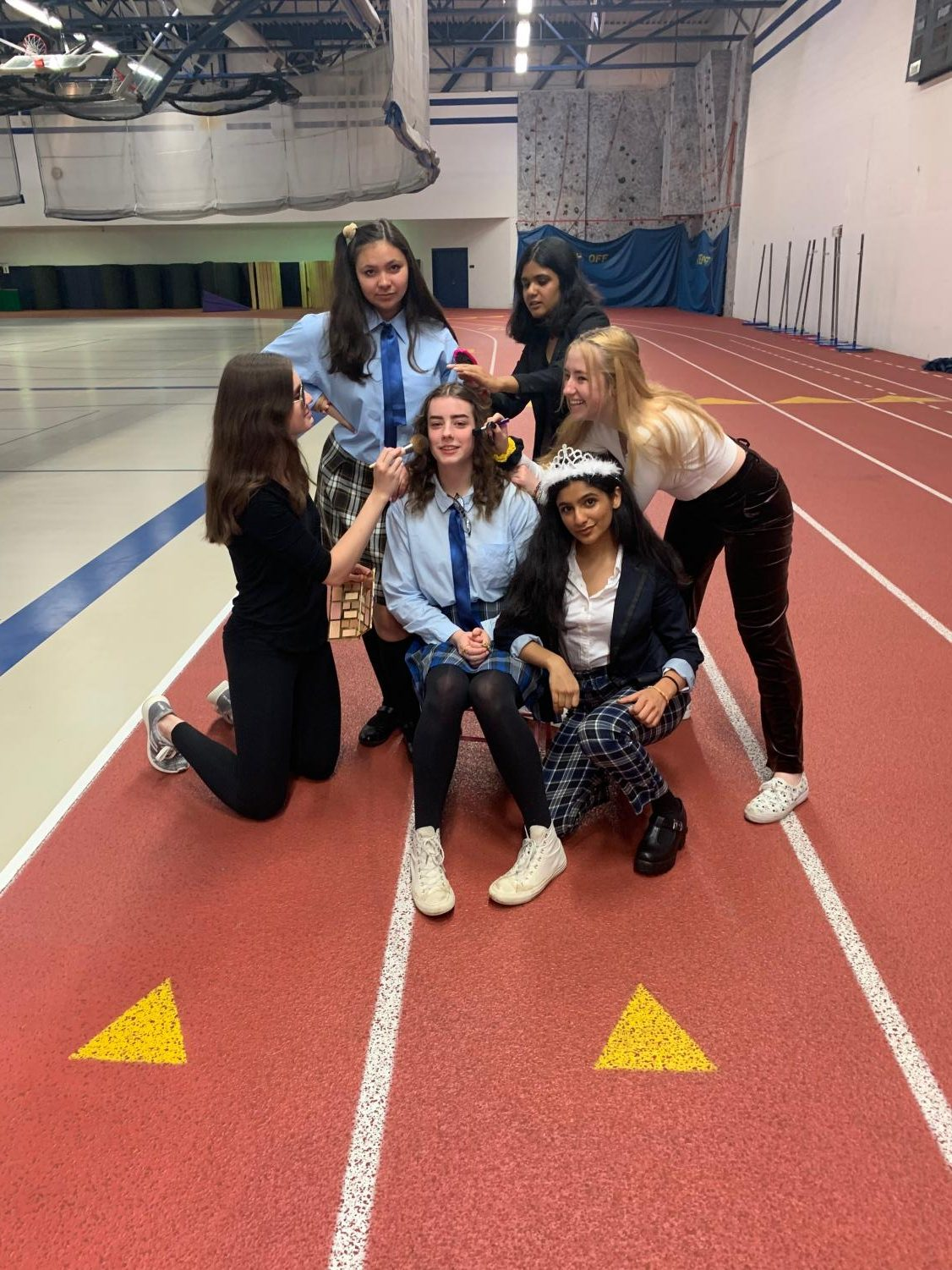 "Juniors Nour Longi,  Chloe Kwasigroch, Kelsi Padalia,  Brooke Kraft, Mary Arundel, and Mackenzie Michaelson  striking a pose after performing their ""The Princess Diaries"" skit, which took the day's first place prize. Kwasigroch said,"