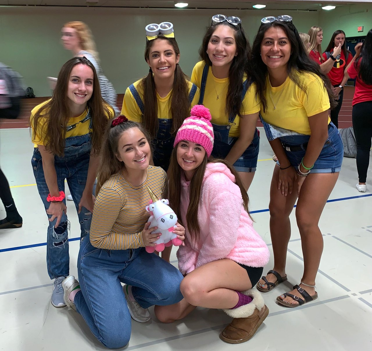 Senior girls dress up as characters from the popular Disney movie Despicable Me.  Top left to right: Jenna Valenti, Kyra Feltz, Gloria Vargas, Adriana Patino.  Bottom Row left to right: Hanna Dworkin, Hannah Troy