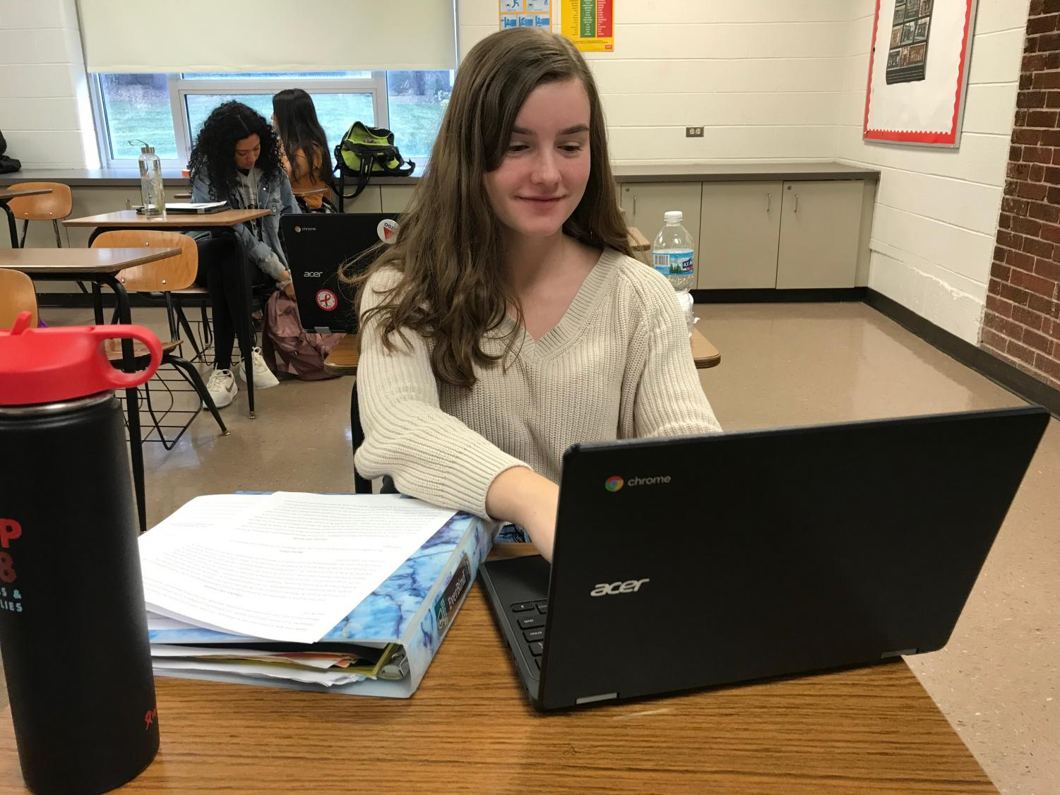Foreign Language Club member Charlotte Albrecht studies French vocabulary during class.