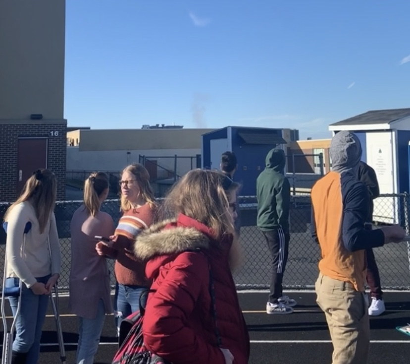 This+shows+how+students+had+to+evacuate+through+the+entrance+near+the+commons.+Many+were+confused+about+why+there+was+smoke+rising+up+from+the+chimney.
