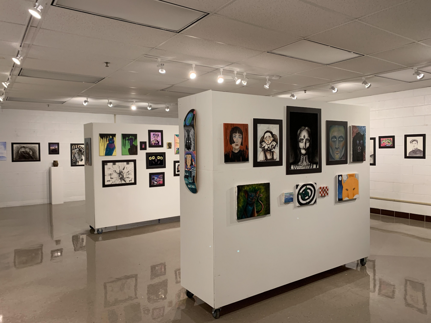 """Gallery 306, organized by the art teachers, showcases artwork created by many students. """"I try to get students to submit their work to the gallery because I am extremely proud of what they have created and how far they have come within the semester or year(s) … Asking if their piece is """"gallery worthy?"""" adds a healthy level of competition. Creating art can both be relaxing and challenging. It's a great way to express yourself and learn new techniques with various materials"""" said ceramic, digital art, and photography teacher Megan Idell."""