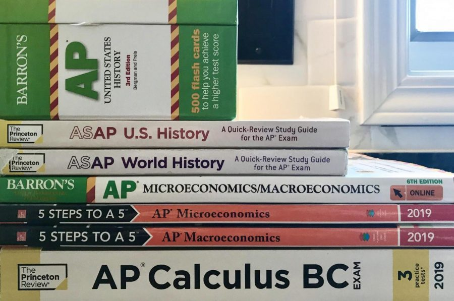 "Despite online preparation resources, prep books remain a popular resource for preparing for AP exams. ""The coronavirus will not stop me from studying for my tests,"" said junior Chloe Kwasigroch."