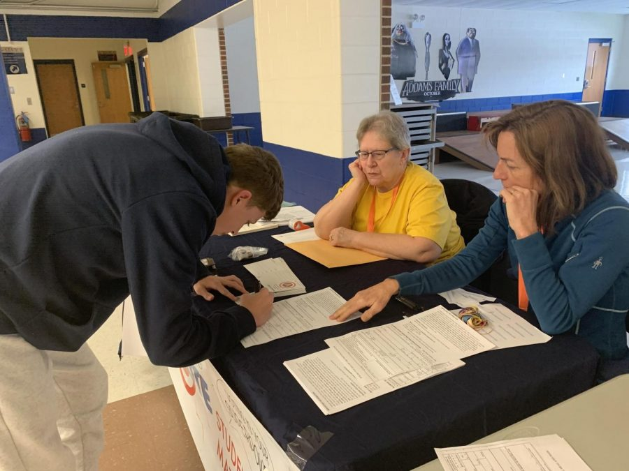"Junior Christopher Calhoun, who will turn 18 on Oct. 14, 2020, registering to vote during his A lunch period. Volunteers from the Cook County Register, Laura Derks and Sharon Storveck, made sure Calhoun filled out the application, which took him five minutes to fill out, correctly. Calhoun said, ""I feel it's your duty as your citizen to vote. It's a right that people in a lot of other countries don't have."""