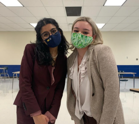 Senior Nour Longi and Sophomore Elle Jeffress posing after the Sectional, ready to compete this upcoming weekend. Photo taken by Philip Lazzari.