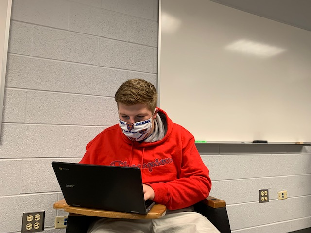 Junior John Vranas studies and prepares for the upcoming PSAT/NMSQT testing on Oct. 13