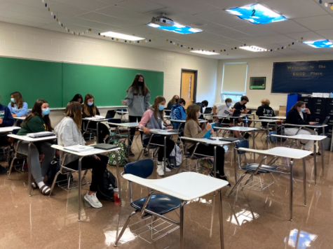 Students in all grades use both chromebooks and physical textbooks to work on lessons.
