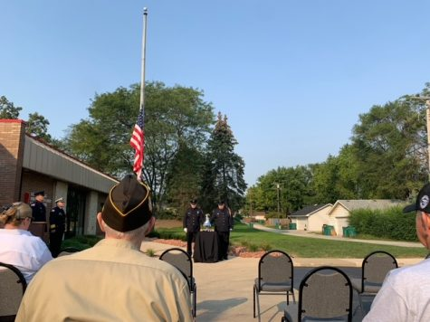 The nations flag hangs halfway down the flagpole at the ceremony, in remembrance of those that lost their lives in the 9/11 attacks.