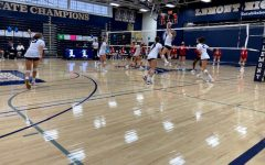 Freshman setter April Rice sets up sophomore Adyson Duvall for a kill.