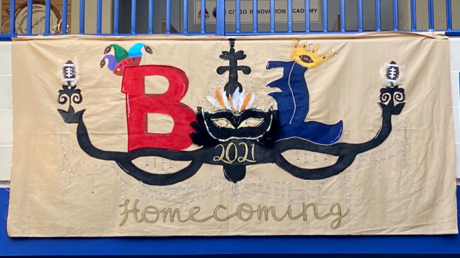 The senior banner paints a chandelier, with the Lemont and Bremen logos on each side. Bremen wears a jester hat, while Lemont wears a crown. Many jewels and gems dangle from the banner.